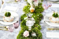 24 a spring fairy tale wedding tablescape with a grass runner with blush roses, crystals, candles, succulents and a lace tablecloth