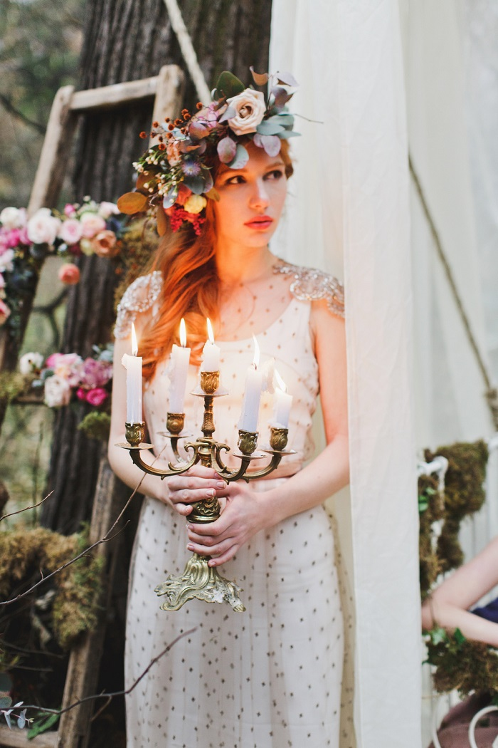 an enchanted wedding dress with a plain underdress, embellished shoulders, polka dots and a lush floral crown