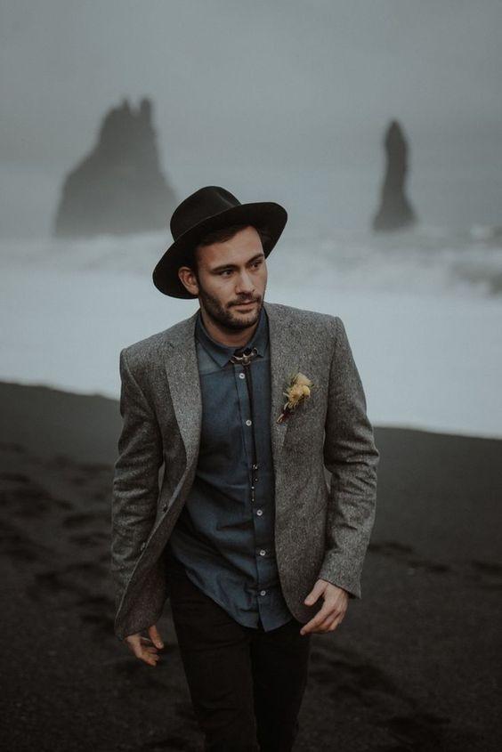 a graphite grey shirt, a grey woolen blazer, a bolo tie, a black hat and black jeans for an adventurous elopement
