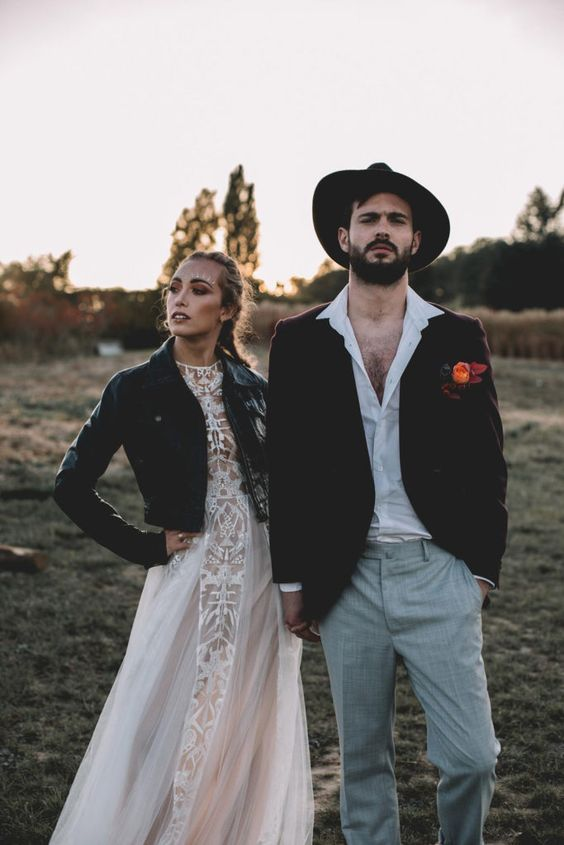 a white shirt, grey plaid pants, a brown velvet blazer and a matching hat for a bold and comfy winter boho wedding