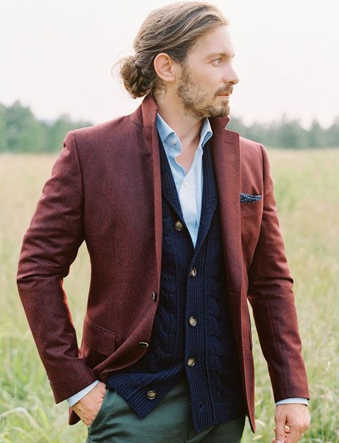 green pants, a blue shirt, a navy cardigan and a red blazer with a navy pocket square for a relaxed boho look