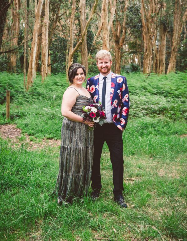 The bride was wearing a silver strap wedding dress and a bold headband, the groom was rocking a bold floral blazer