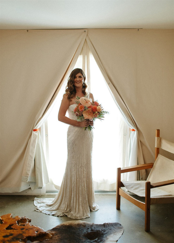 The bride was wearing an embellished lace off the shoulder wedding dress with a train and carrying a very bright bouquet