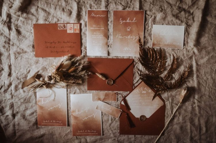 The wedding stationery was done with a watercolor effect and in rust shades