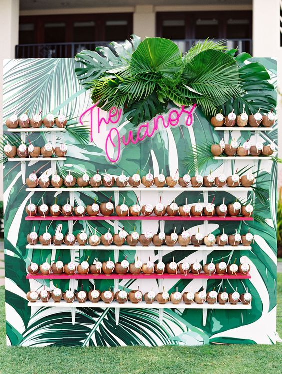 a bold tropical wall with colorful shelves and drinkable coconuts, with lush leaves and pink neon