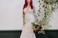 03 One bride was wearing a boho lace A-line wedding dress with a deep neckline and a train