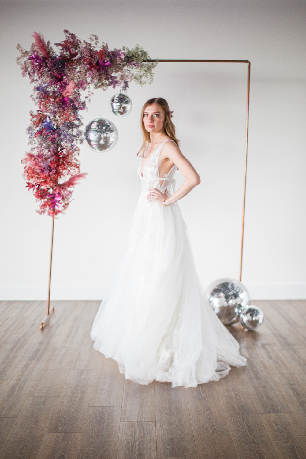 The bride was wearing an A line floral applique wedding dress with a train and cutout sides