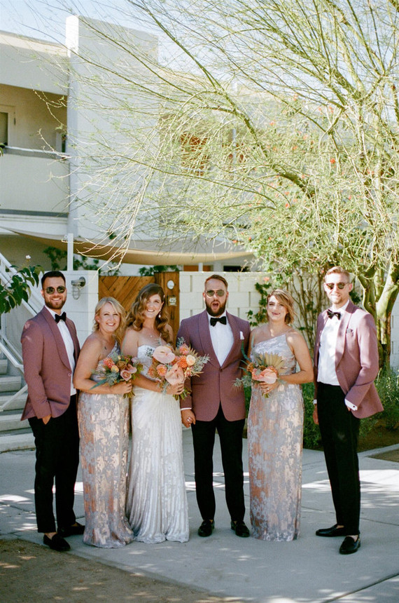 The groom and groomsmen were wearing mauve blazers, black pants and loafers, black bow ties, the bridesmaids were wearing elegant lace shiny dresses