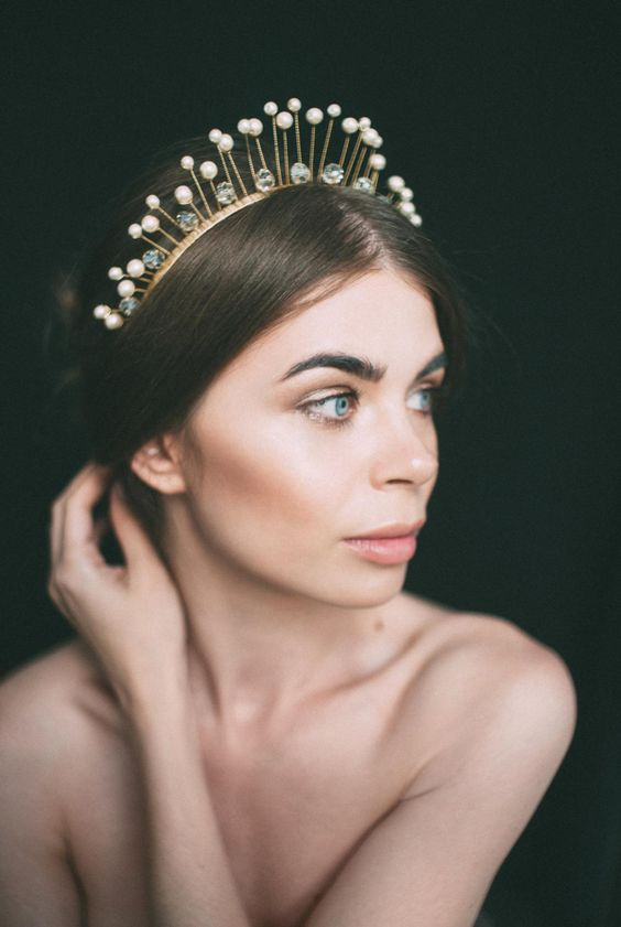 a catchy pearl and crystal bridal headpiece is a trendy accessory for a modern bride who loves tiaras