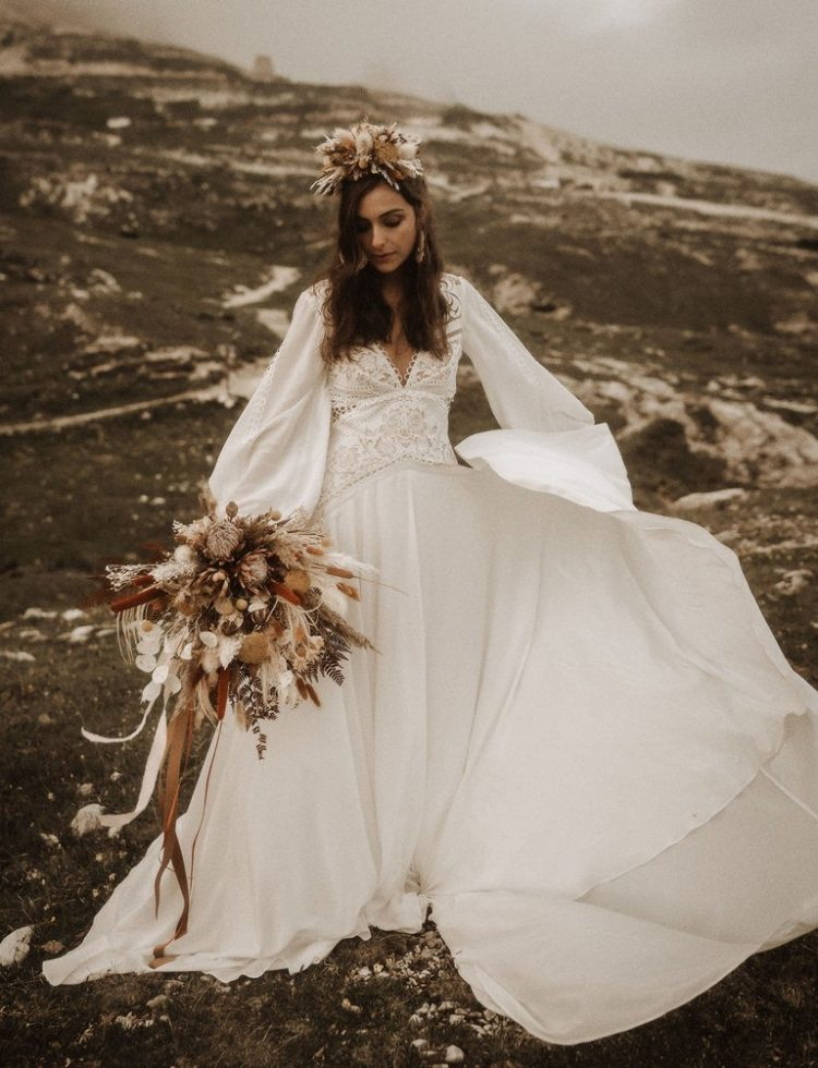 The bride was wearing a boho wedding dress with puff sleeves, a boho lace bodice and a plain skirt plus a floral headpiece