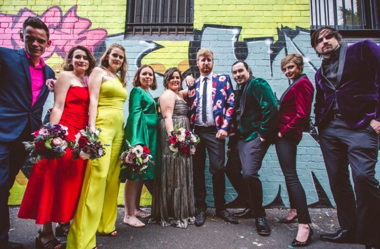 The groomsmen and a groomsmaid were also rockign jewel tones - emerald, purple and fuchsia wearing velvet blazers