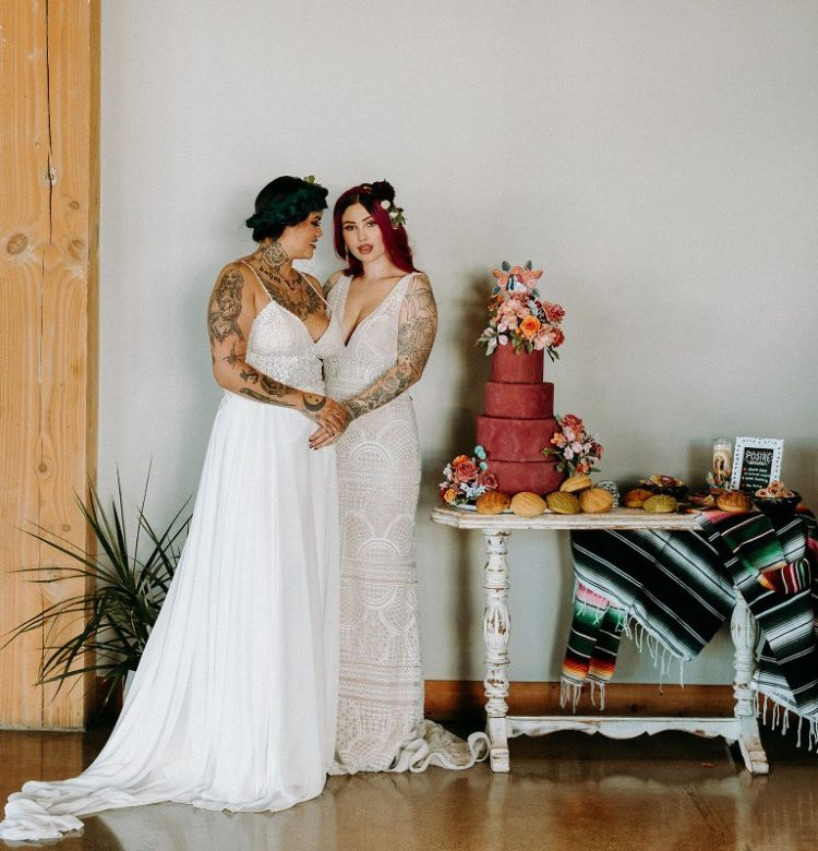 The second bride was wearing an A-line wedding dress with an embellished bodice and a pleated skirt, both girls were rocking bright hair