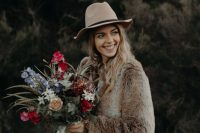 04 a brown faux fur bridal coat and a neutral hat are a nice idea for a fall or winter boho bride