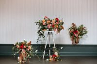 05 Bright floral arrangements with plenty of greenery and much texture were created for the wedding shoot