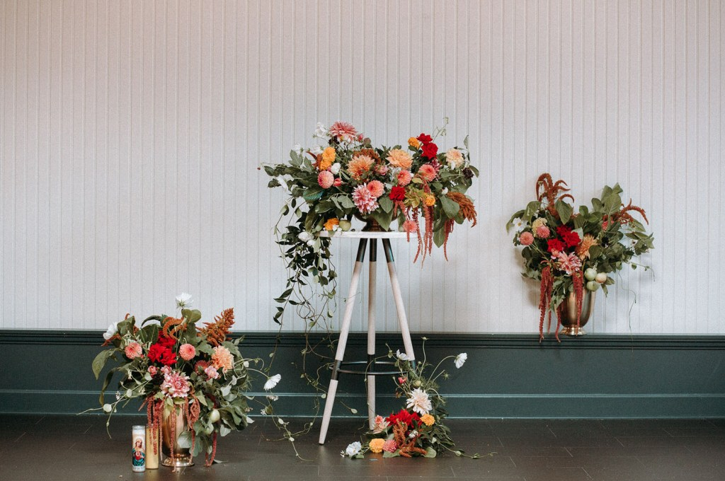 Bright floral arrangements with plenty of greenery and much texture were created for the wedding shoot