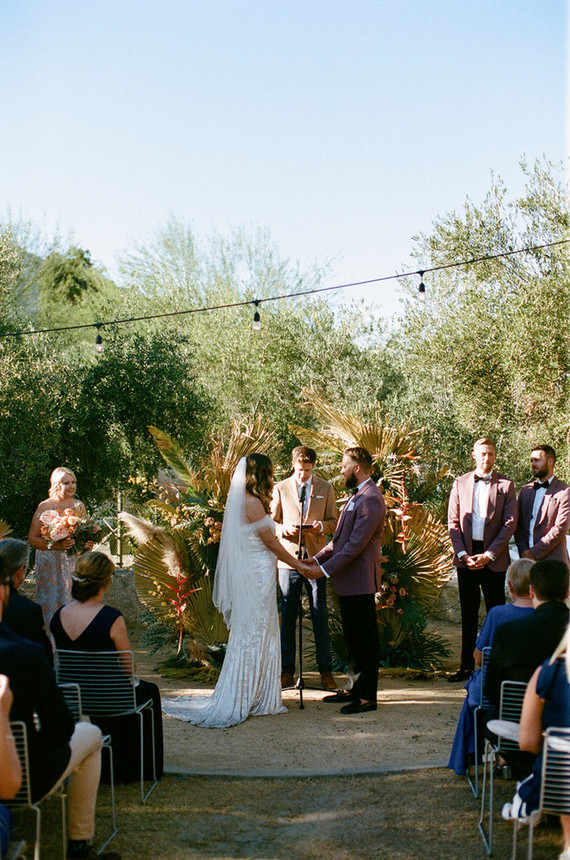 The wedding altar was decorated with greenery, dried blooms and leaves and some pampas grass