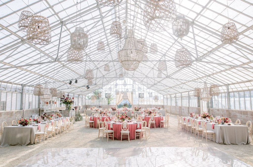 The wedding reception was done airy, with woven lamps and chandeliers