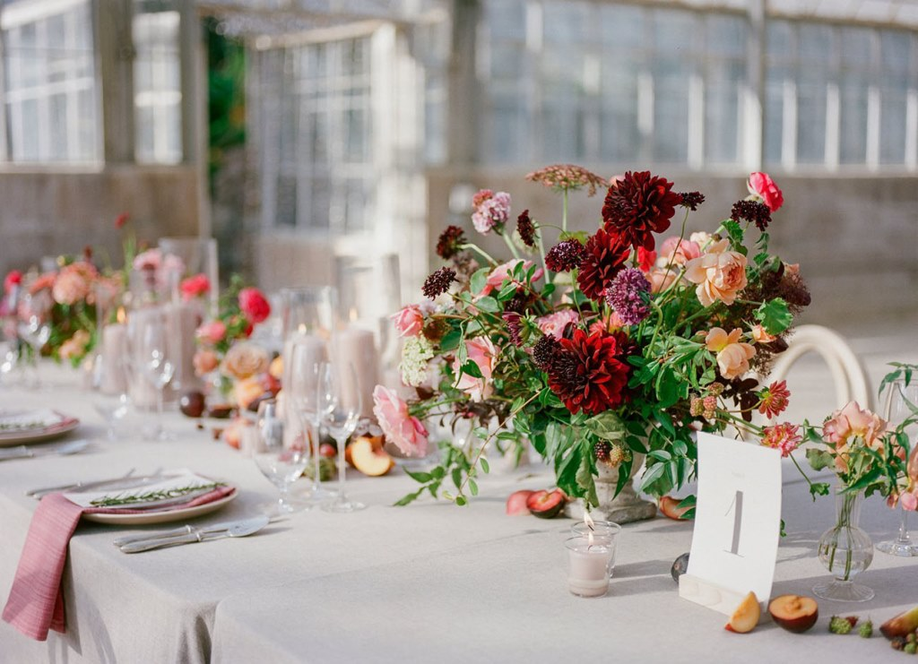 The wedding centerpieces were done with bold blooms and greenery