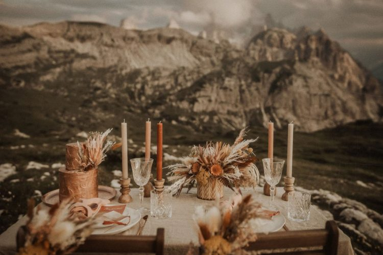 There was a small picnic table done with colroed candles, a dried flower and grass centerpiece and rust napkins and stationery