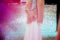 06 a whimsical pink faux fur coat with embroidred iridescent angel wings is a fantastic and breathtaking piece to wear