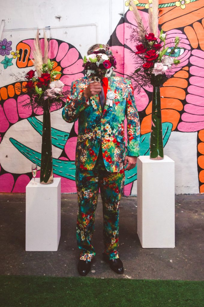 One more his look with a super bold floral suit in a wide range of colors
