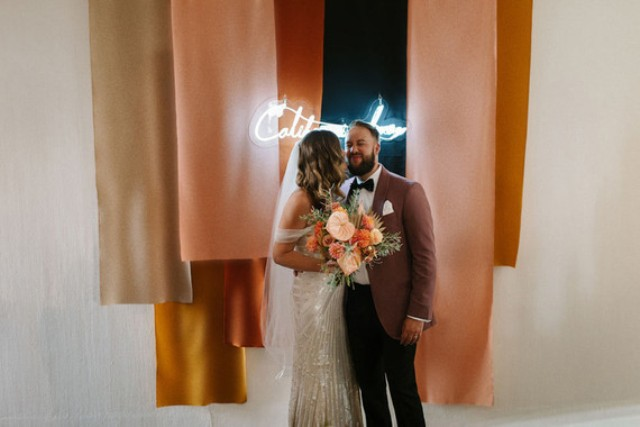 The wedding backdrop was a bold color block one, with a neon sign