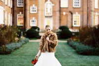 07 a classic brown faux fur coat over a mermaid wedding dress adds color and a luxurious feel to the outfir