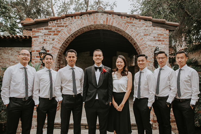 The groomsmen were wearing black pants, white shirts and printed ties for a modern look