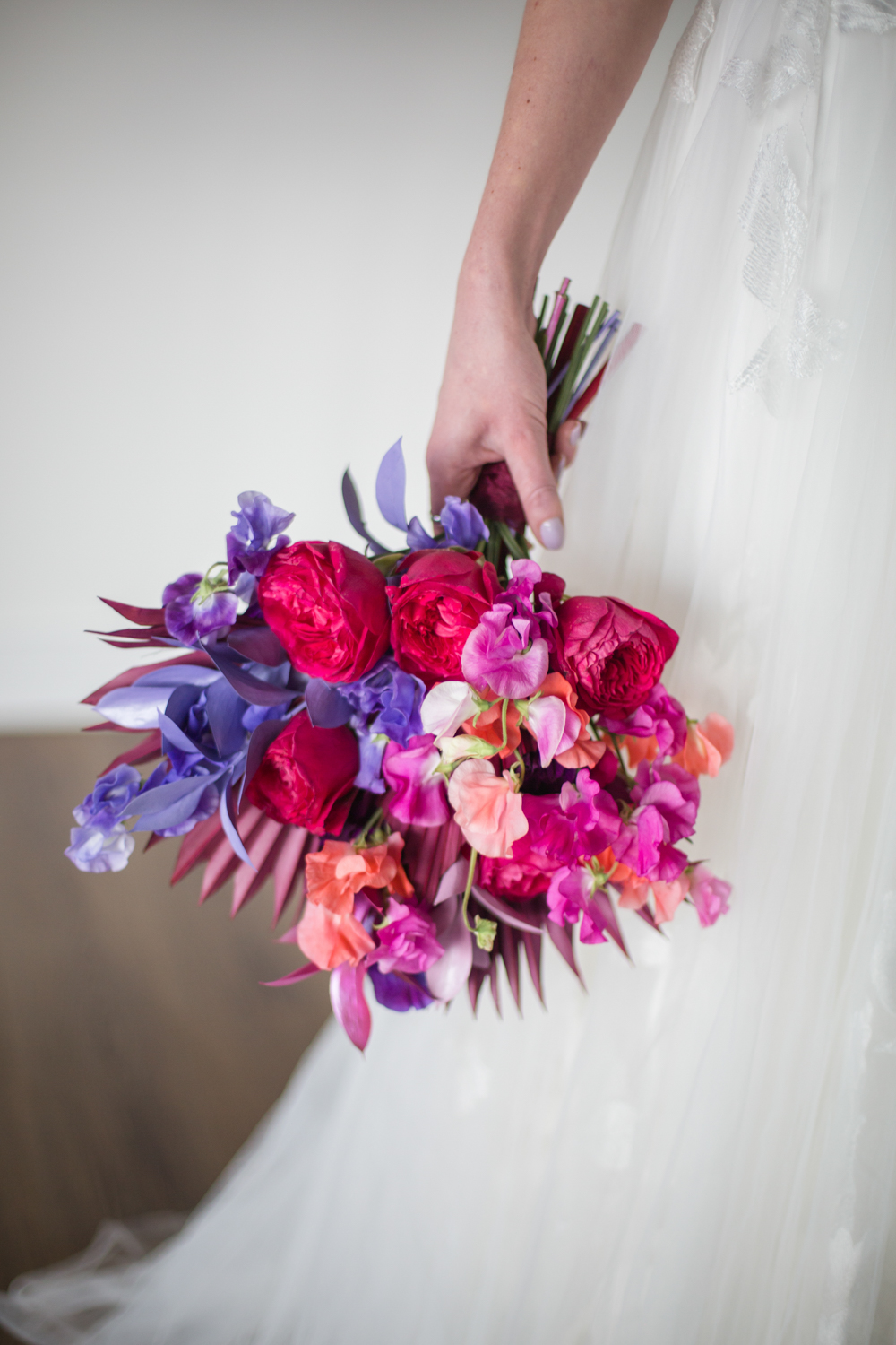 The wedding bouquet was super bright, with bold blooms and bright dried elements