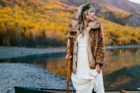 08 a fur coat and comfy brown boots make the bridal look complete and she feels comfortable outside