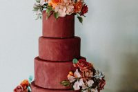 09 The wedding cake was a matte burgundy one, decorated with bold blooms and there were some traditional cookies served