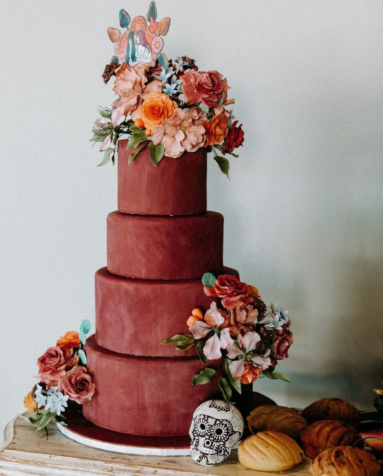 The wedding cake was a matte burgundy one, decorated with bold blooms and there were some traditional cookies served