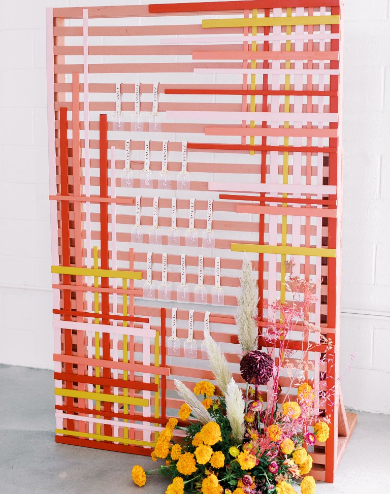 This is a very creative and bold modern way to organize a wedding seating chart