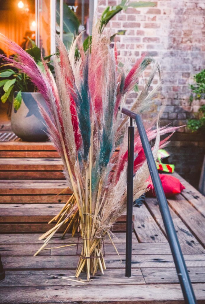 Bright pampas grass decorated the lounge and made it fun and playful