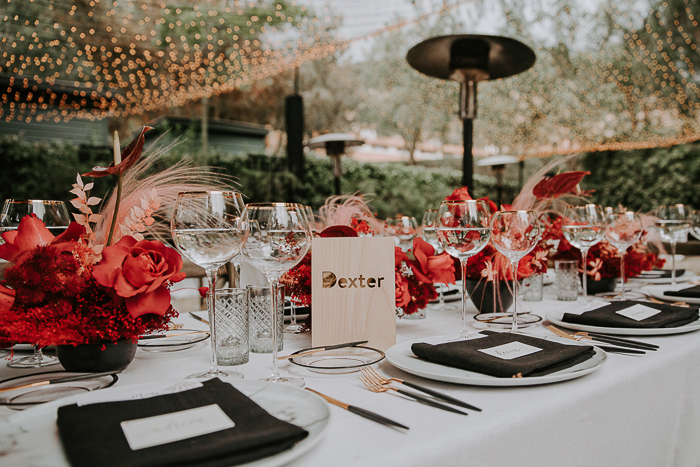 The wedding tablescape was done very bold, in black, white and red, with gold touches