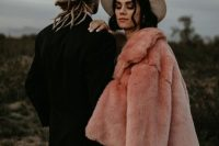 11 a gorgeous pink faux fur coat over a romantic boho lace wedding dress plus a hat for a boho bridal look