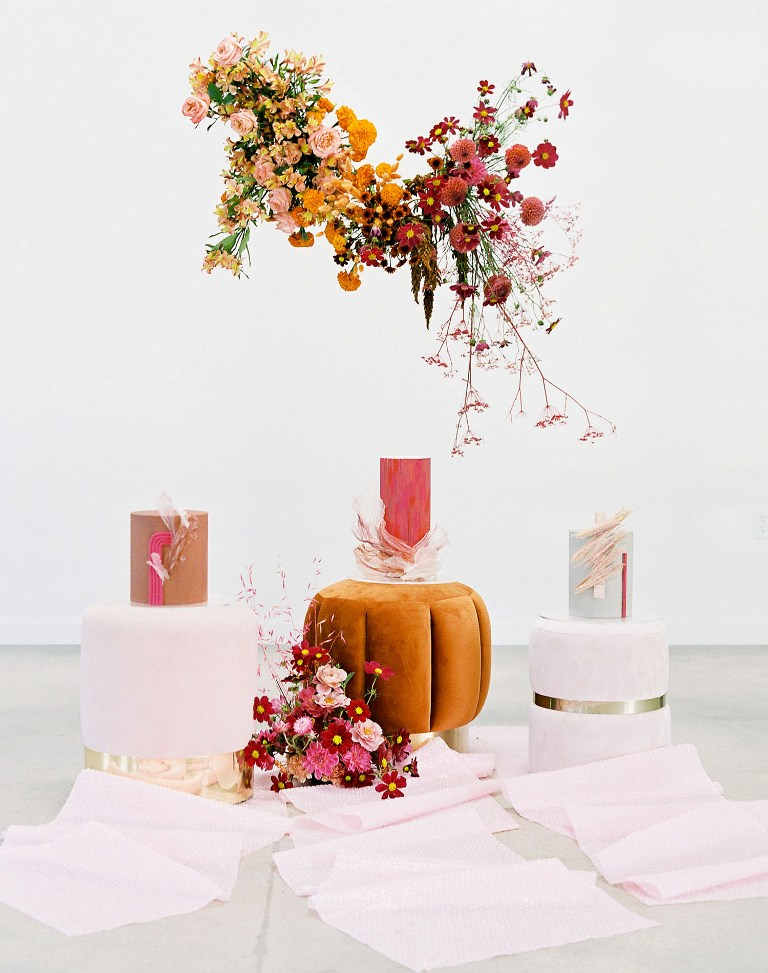 These three amazing wedding cakes with bold decor and much texture and an overhead installation just make me drop my jaw