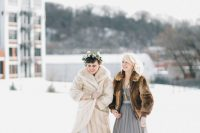 13 a long neutral faux fur coat over a wedding dress, black boots for feeling comfortable at a wedding outdoors