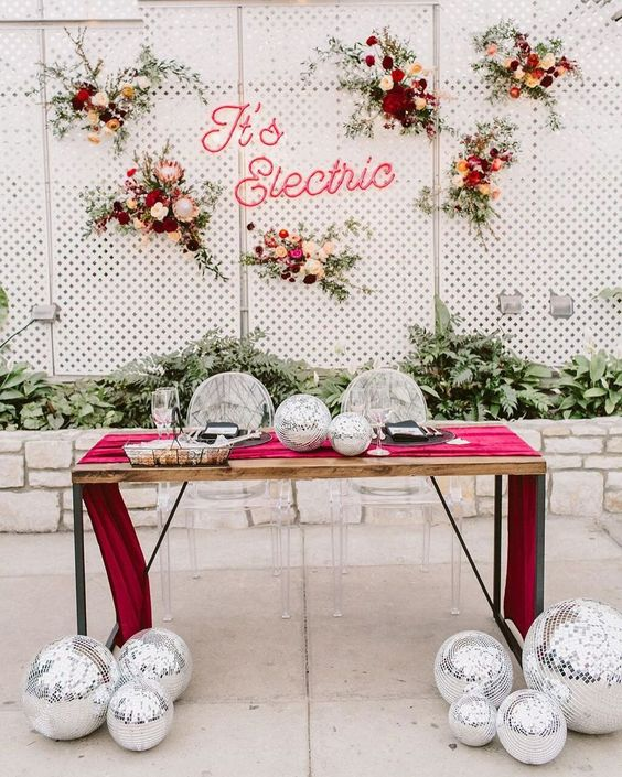 disco balls at the table and on it for decorating the head table and make it bold and outstanding