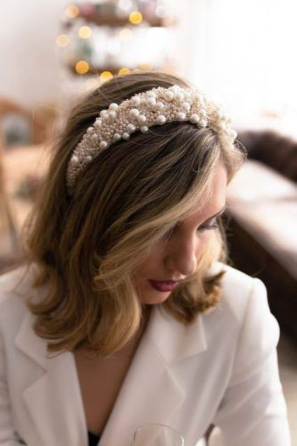 wavy hair down and a pearl headband with pearls of various sizes for a slight 70s inspired look