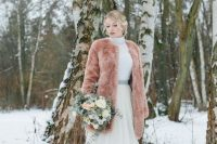 16 a peach-colored teddy coat is a gorgeous way to add color to your look and stand out in the snow