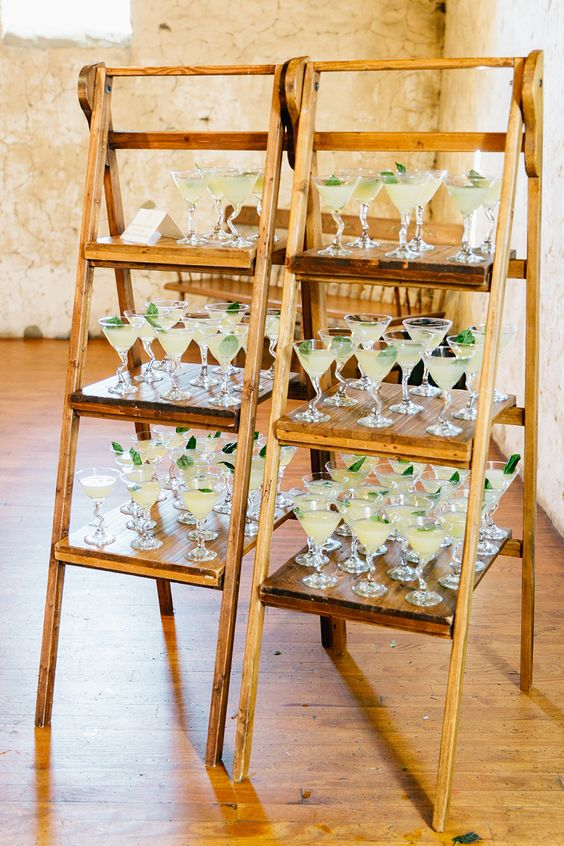 wooden ladders with drinks are perfect for a rustic wedding