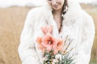 18 a white faux fur coat like this one will keep you warm for sure, whatever the weather is and you'll enjoy your wedding