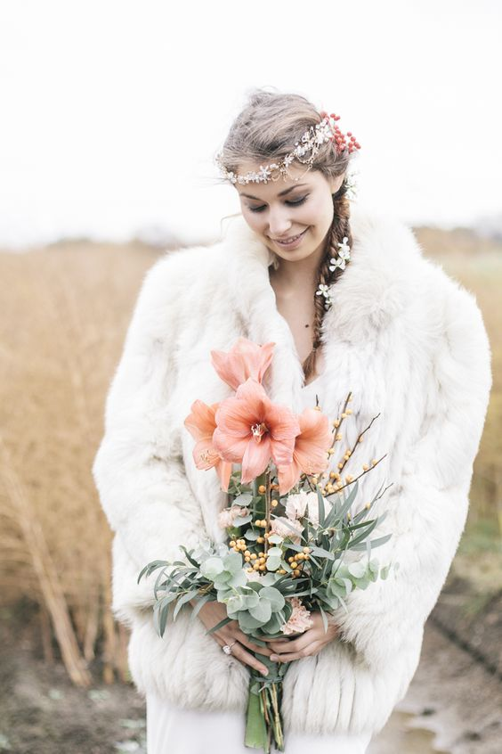 a white faux fur coat like this one will keep you warm for sure, whatever the weather is and you'll enjoy your wedding