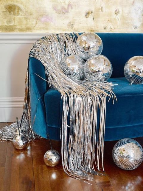 spruce up your wedding lounge with disco balls and some silver fringe to make it ultimately bold and cool