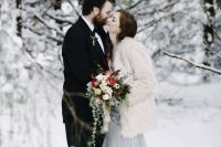 22 a white fuzzy fur coat over a grey embellished wedding dress is a trendy and chic idea to keep you warm