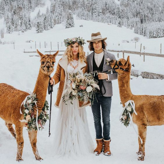 a brown shearling coat with white faux fur put on over a wedding dress is a comfortable and beautiful idea