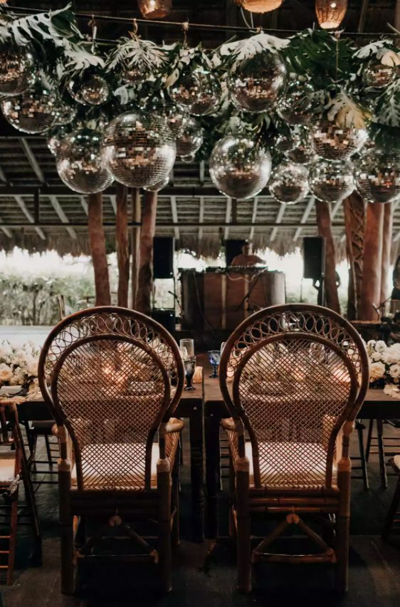 highlight your head table with tropical leaves and disco balls hanging over it and make it wow