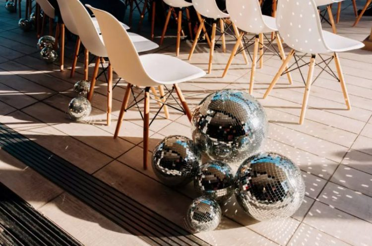 line up the wedding aisle with oversized disco balls to make it look ultimately bold and non-typical