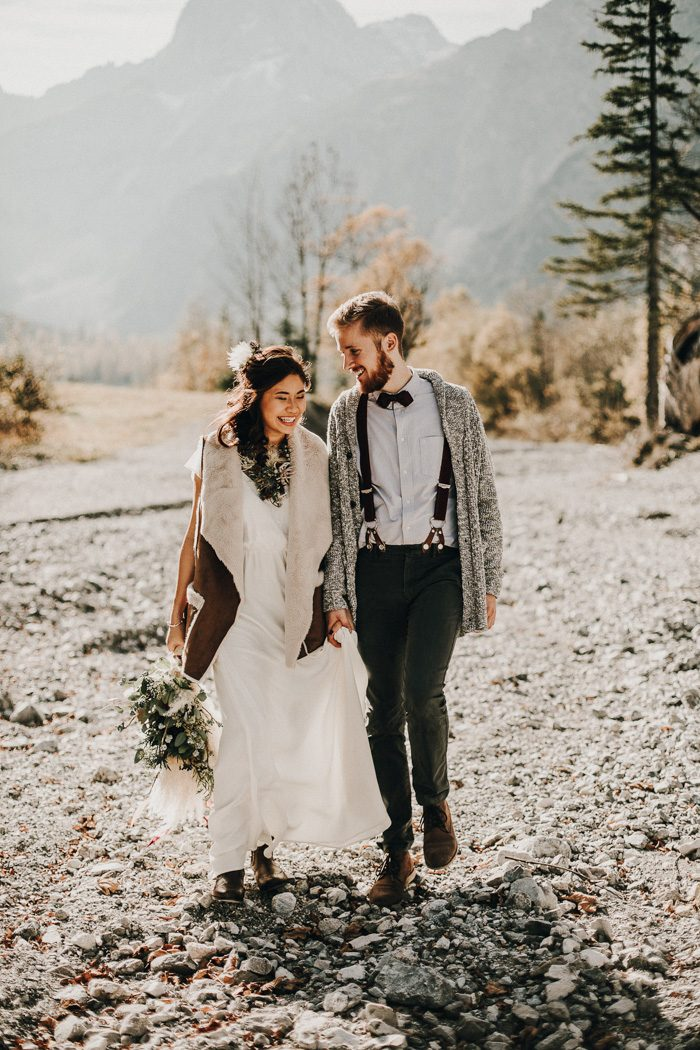 a plain boho wedding dress plus a brown shearling coat with faux fur in neutrals to complete a boho bridal look